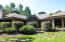 The backyard offers privacy and beautiful landscaping