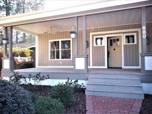 Beautiful Southern Pines location with large fully fenced yard and mature landscaping
