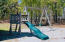 Playing area with swing and slide
