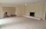 Living room w/ fireplace & new carpet