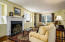 Spacious 32' x 24' room is punctuated by 9' ceilings and hand molded plaster ceilings and walls