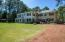 The 22' x 16' Deck, Octagonal gazebo, and sweeping lawn, conducive to entertaining, provide unobstructed views of the majestic magnolia, long-needle pine trees, and established botanicals; as well as the Mid-Pines fairways