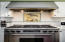 Gourmet Kitchen layout with one Dacor 6 burner gas range + auxiliary Dacor electric oven + a Dacor warming drawer