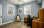 The slate look, wood laminate flooring carries over from the kitchen and butler pantry into the office and den for seamless appeal Office area has a half bath