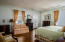 With a nod of being one of the original master suites, the distinctive attributes of this suite include an en-suite bathroom, cedar lined closet and a private sitting room/sleeping porch that looks out to the yard and rolling fairway views