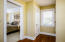 A dressing hall that accommodates a vanity and two additional closets
