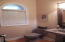 Powder room off of main hallway.