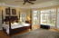 Master bedroom ensuite with great views of the wooded backyard and GC.
