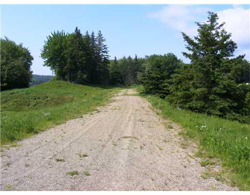 Land/Lot. A partial gravel road...