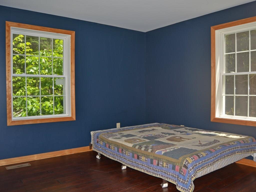 The master bedroom has a large...