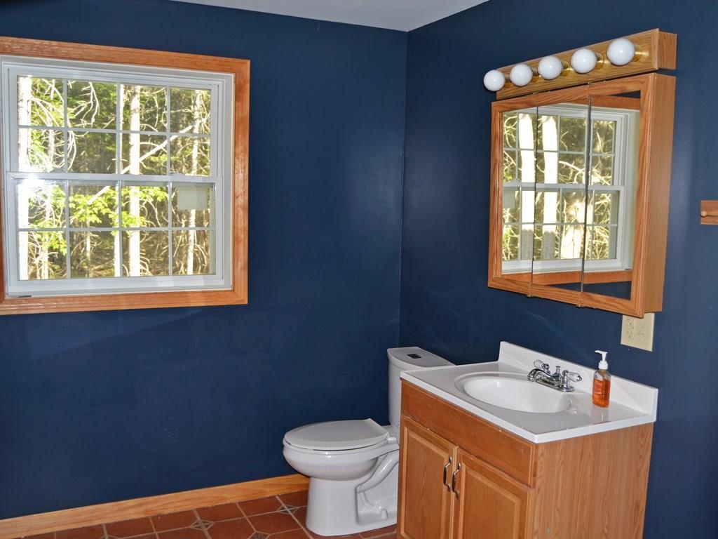 The bathroom has a tile floor and a...