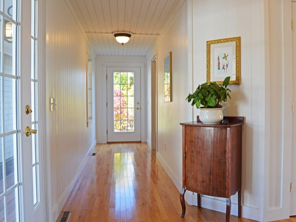 Hallway off the mudroom leads to the...