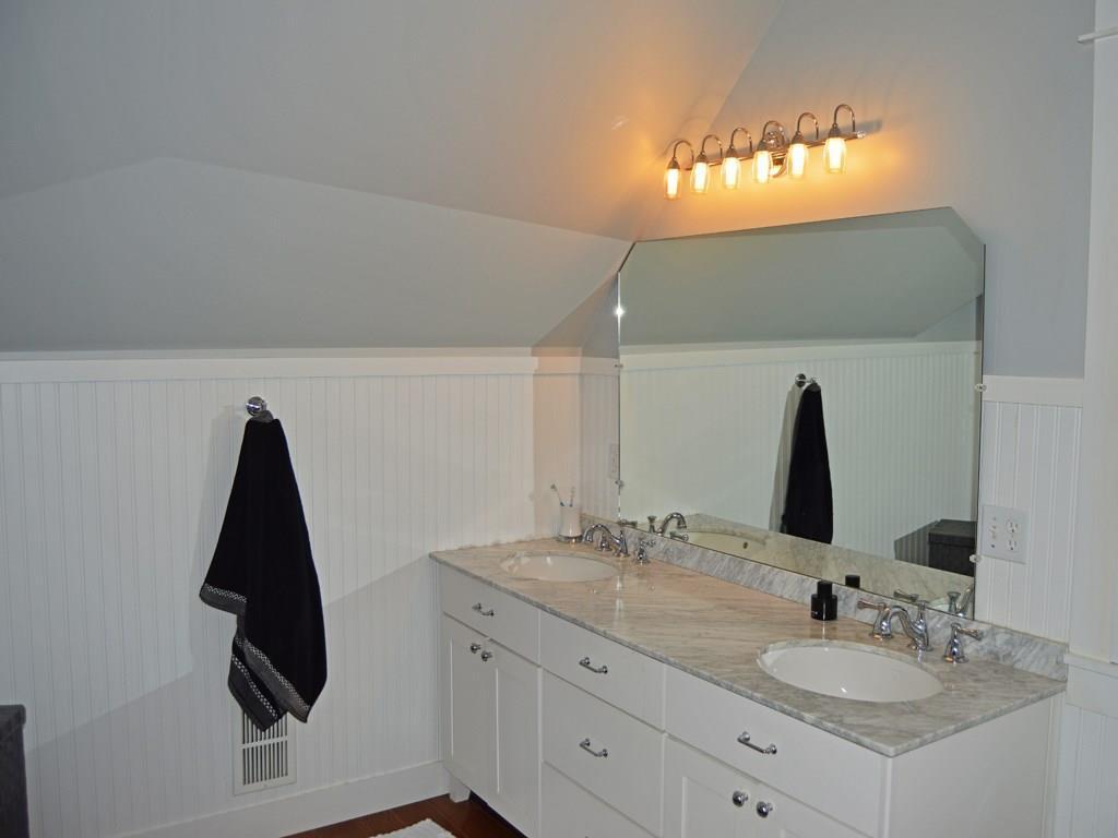 The Master Bathroom has a marble...