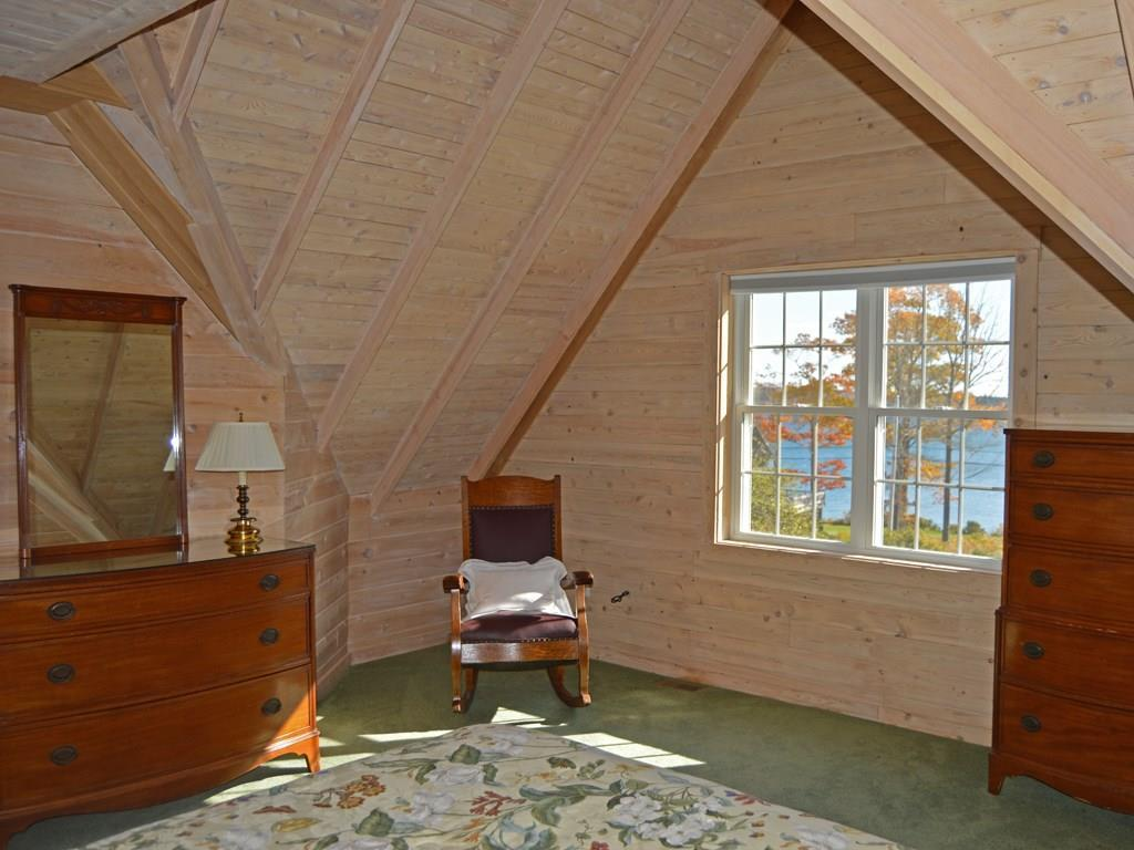Large guest bedroom with cathedral...