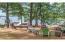 Firepit, toys, dock, pontoon boat, looking down Long Lake
