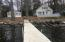 Great view of the cottage and home from the dock. Dock system conveys.