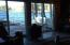 View to the deck, dock and long lake from living room, Main House