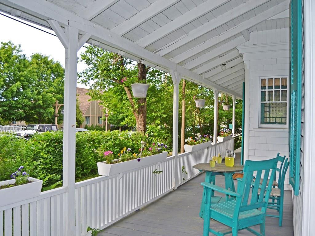 Lovely covered porch enjoys a view...