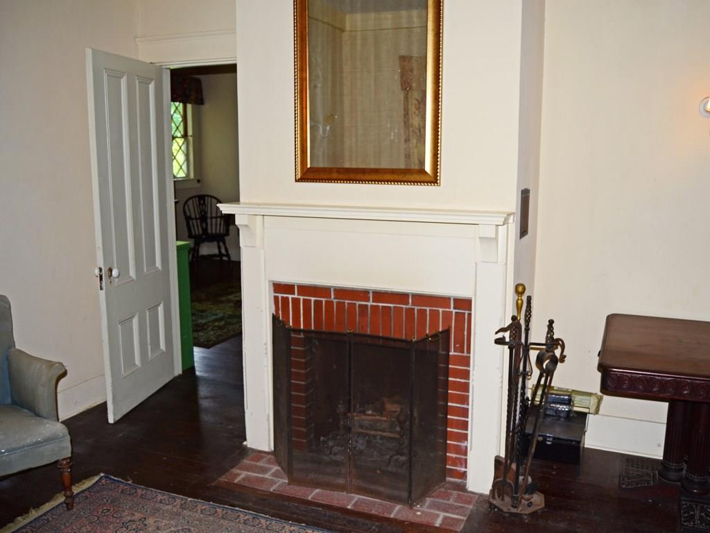 The fireplace in the parlor. This is...
