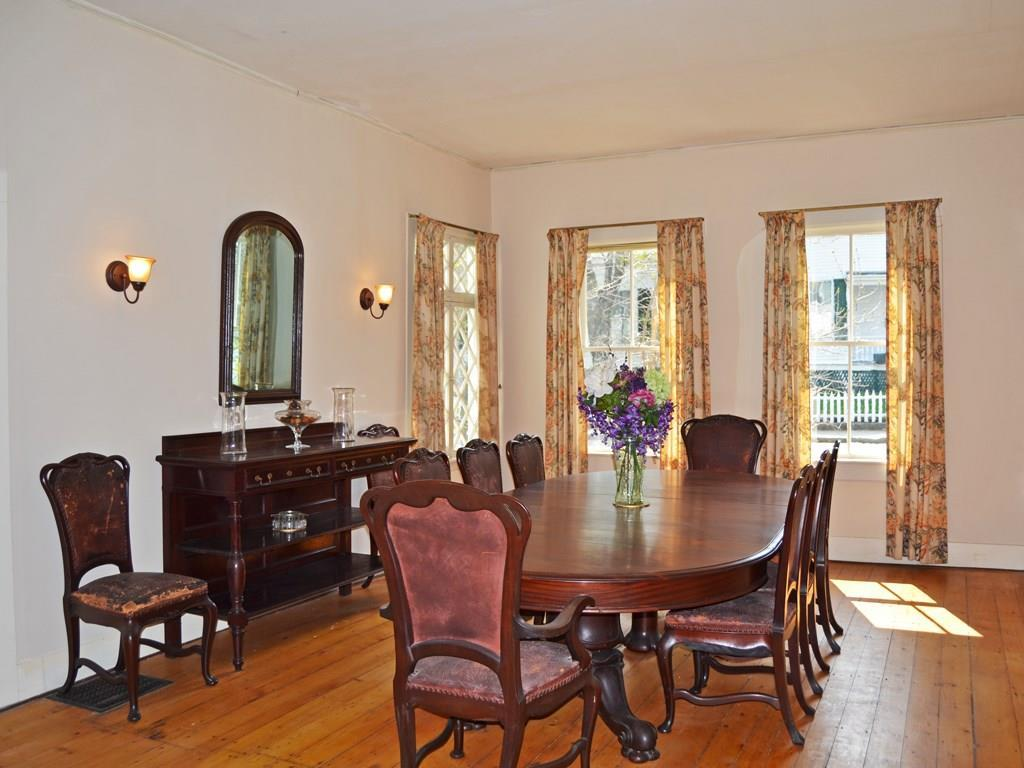 Large formal dining room with...