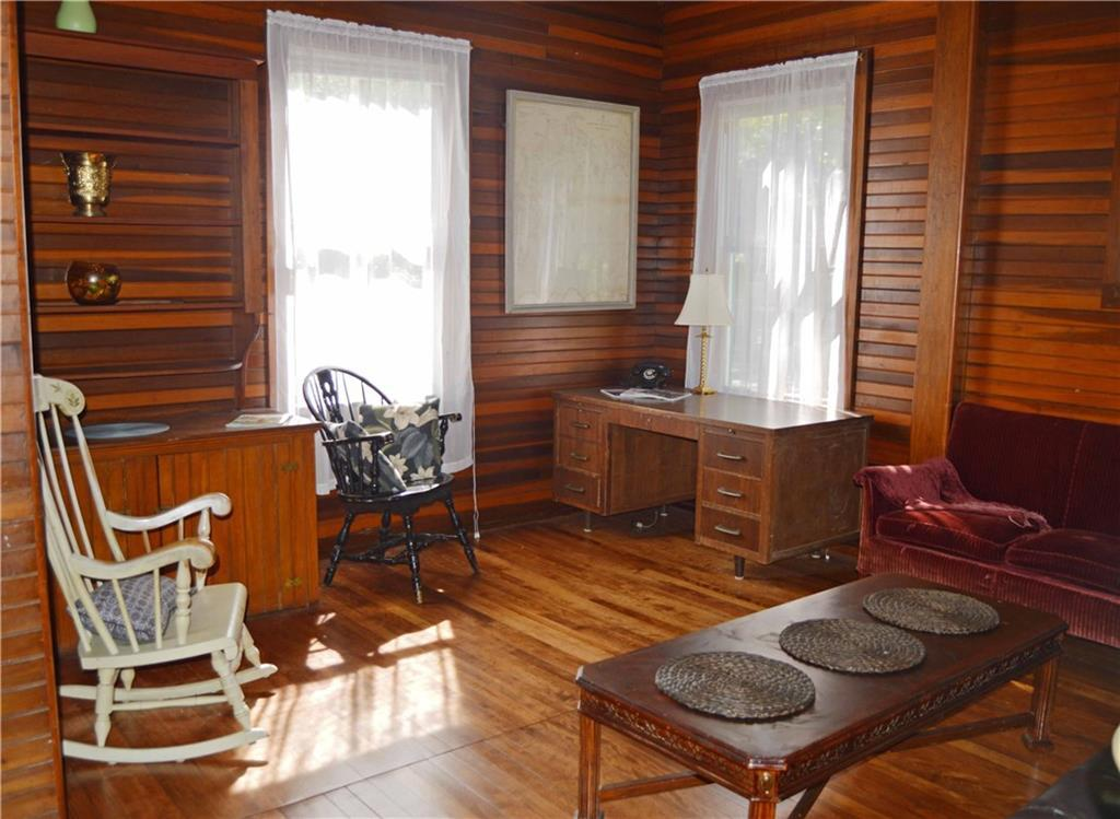 This wood-paneled den/office.