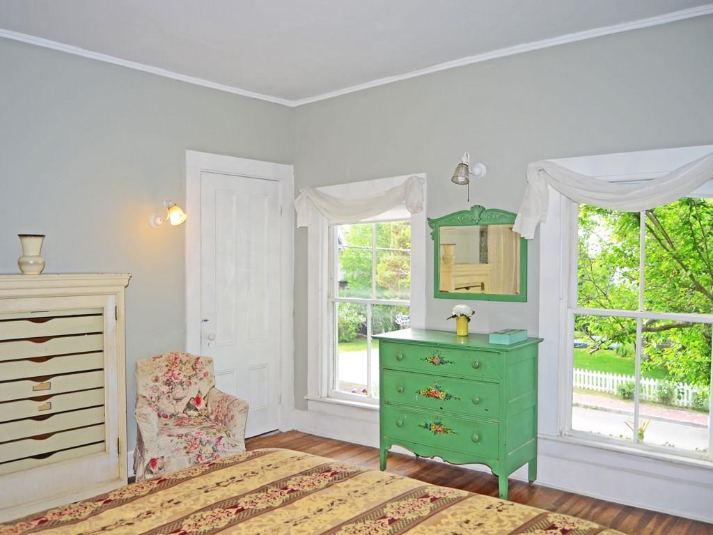 Sunny guest bedroom with private...