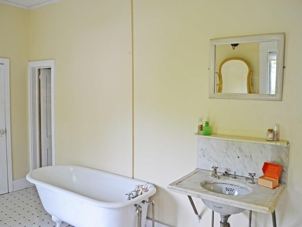 Large bathroom with claw foot tub...