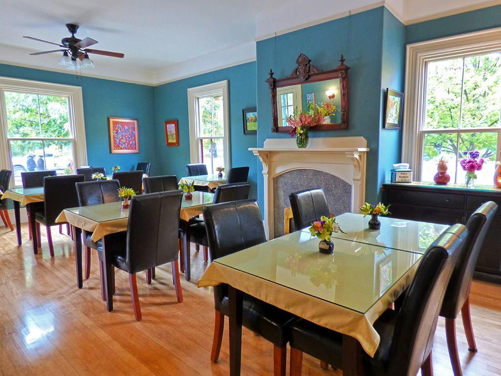 The sun-drenched dining room is...