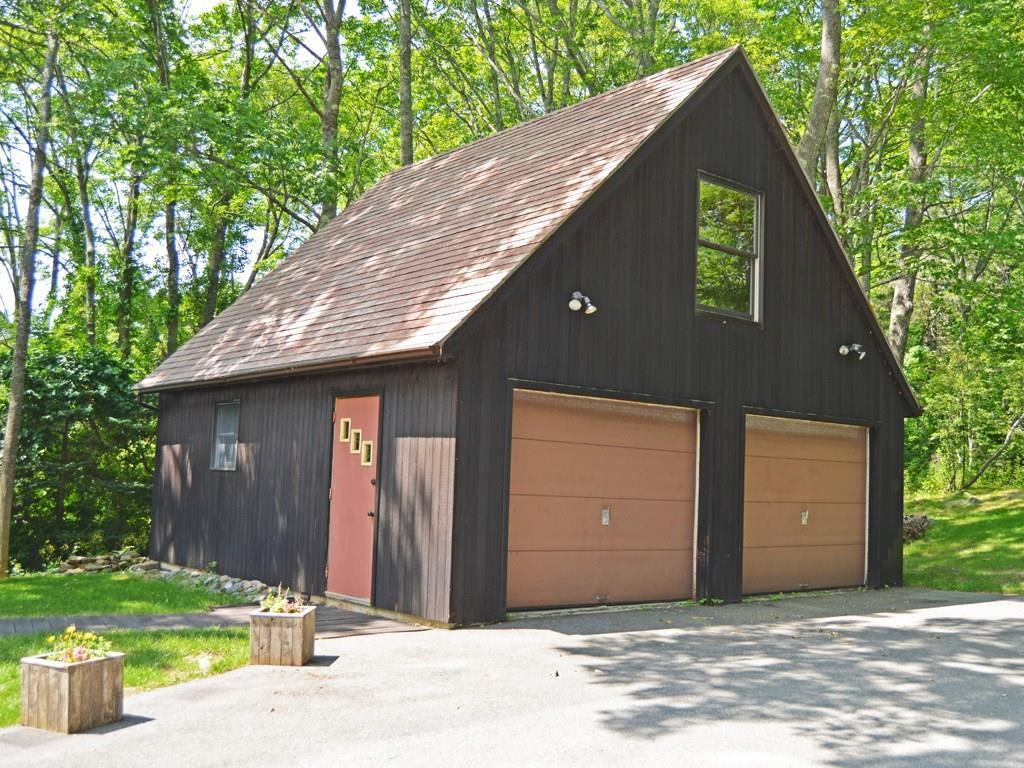 Large 2-bay garage with ample...