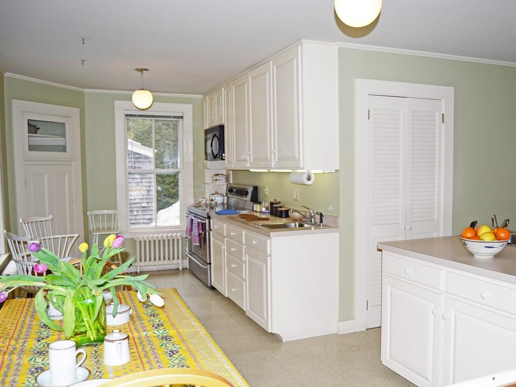 Kitchen with pantry and door to parking.