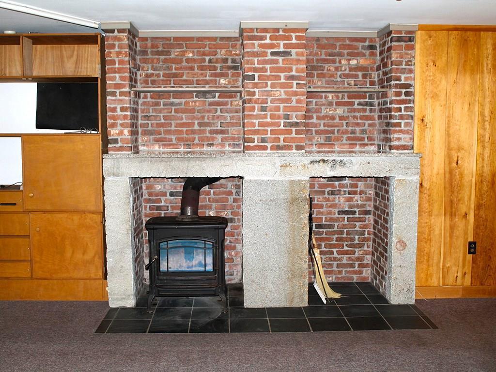 Woodstove with brick and granite...
