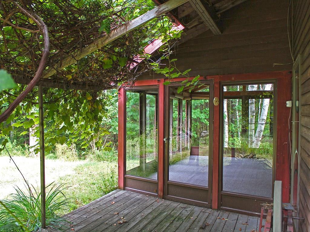 Patio and grape vine with sun porch