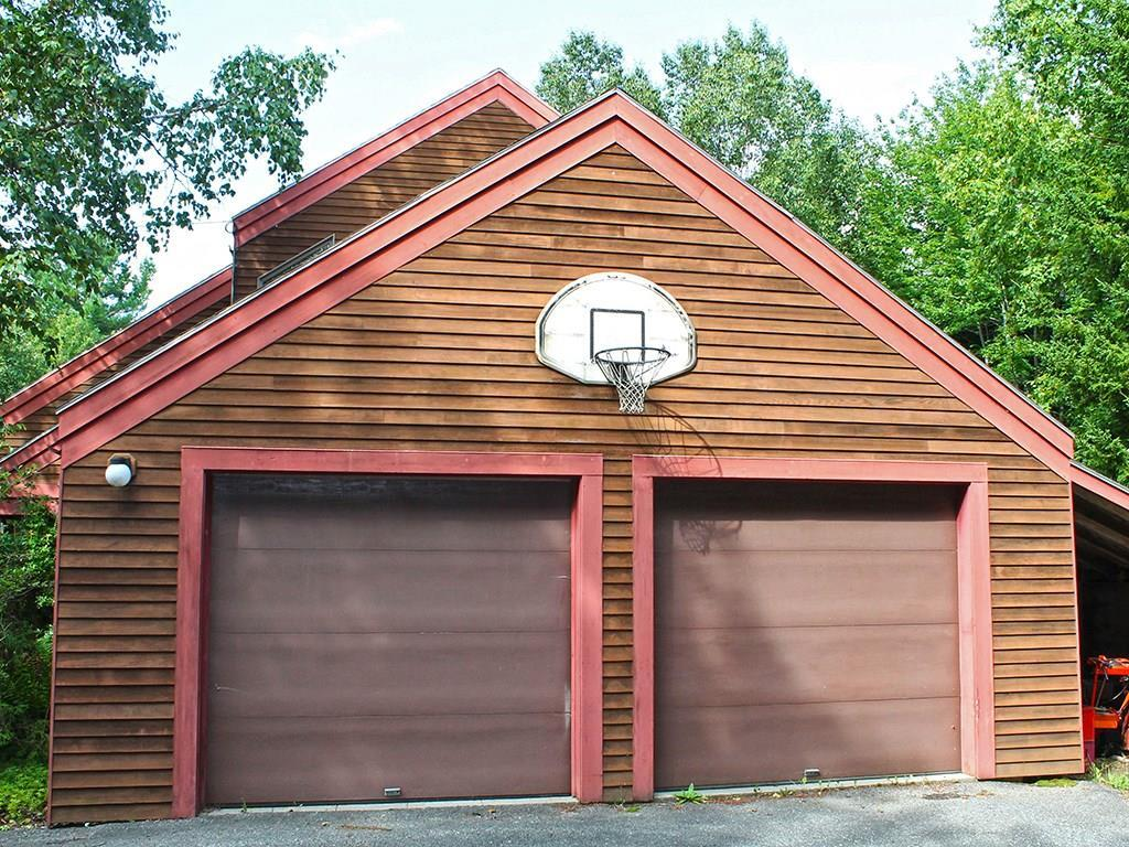 Two car garage. The left bay is...