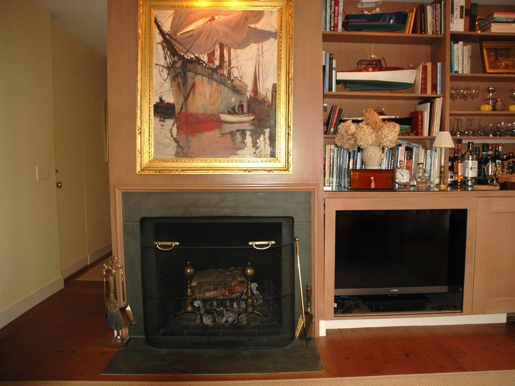 Den fireplace and built-in cabinetry