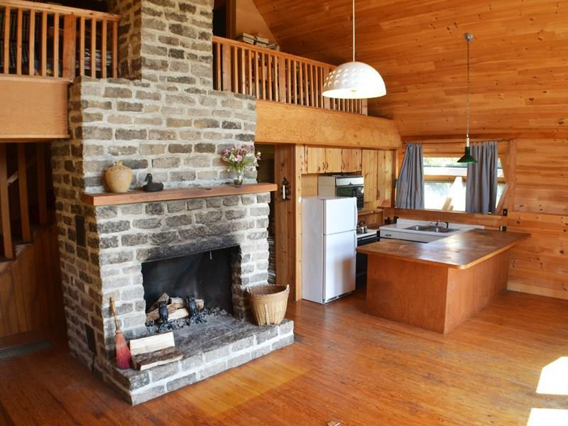 Central granite fireplace in open...