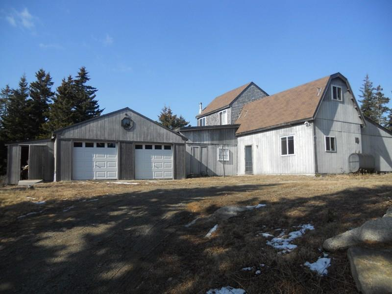 2-car garage and large outbuilding...