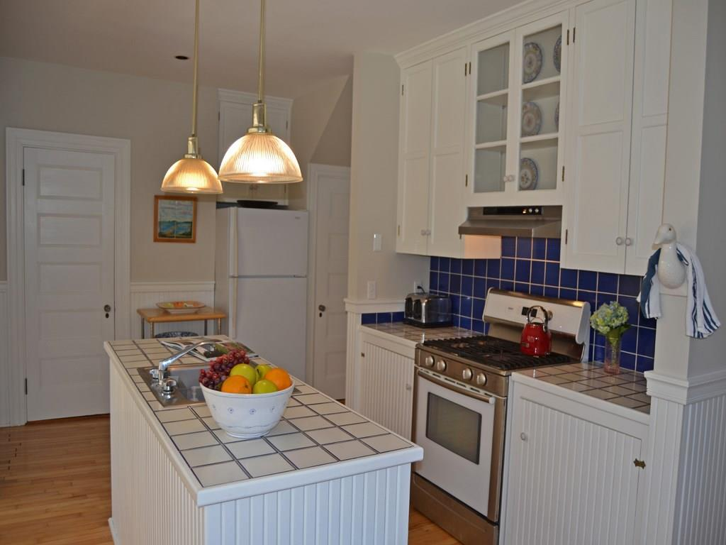Fully equipped sunny kitchen with...