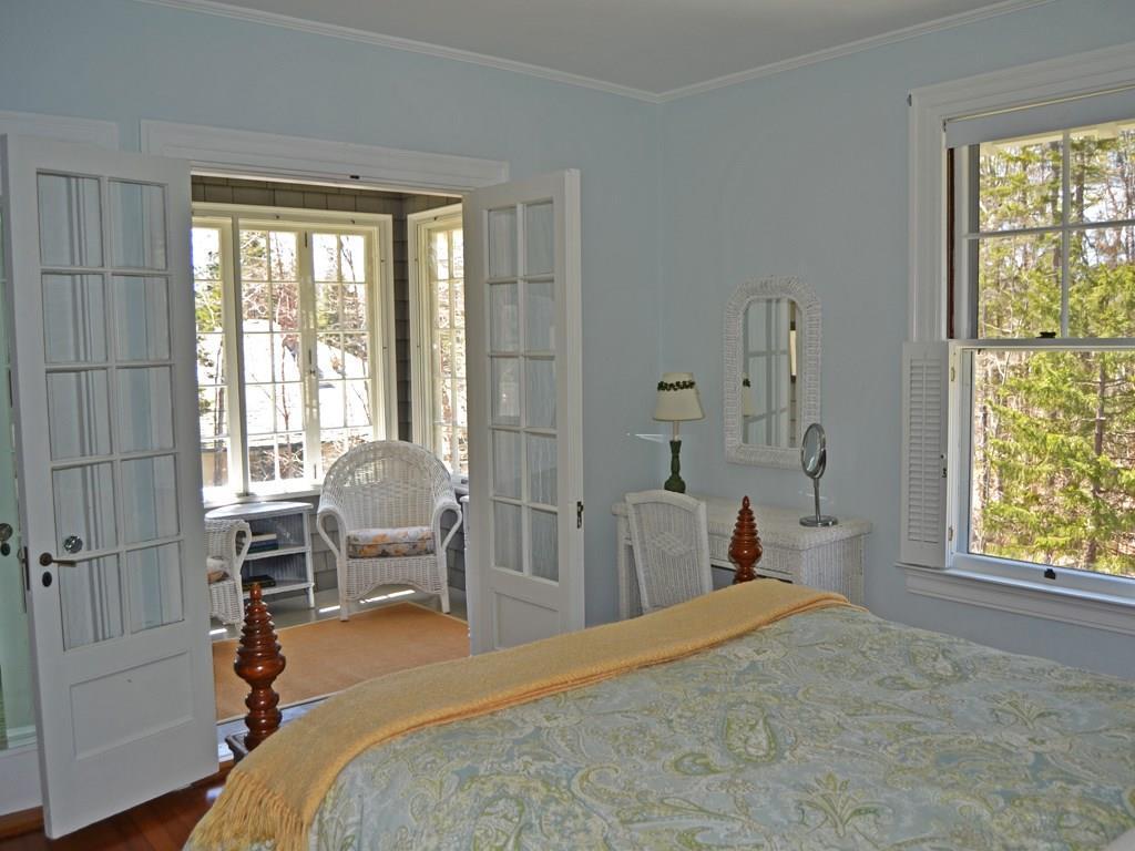 Master bedroom sleeping porch. A...