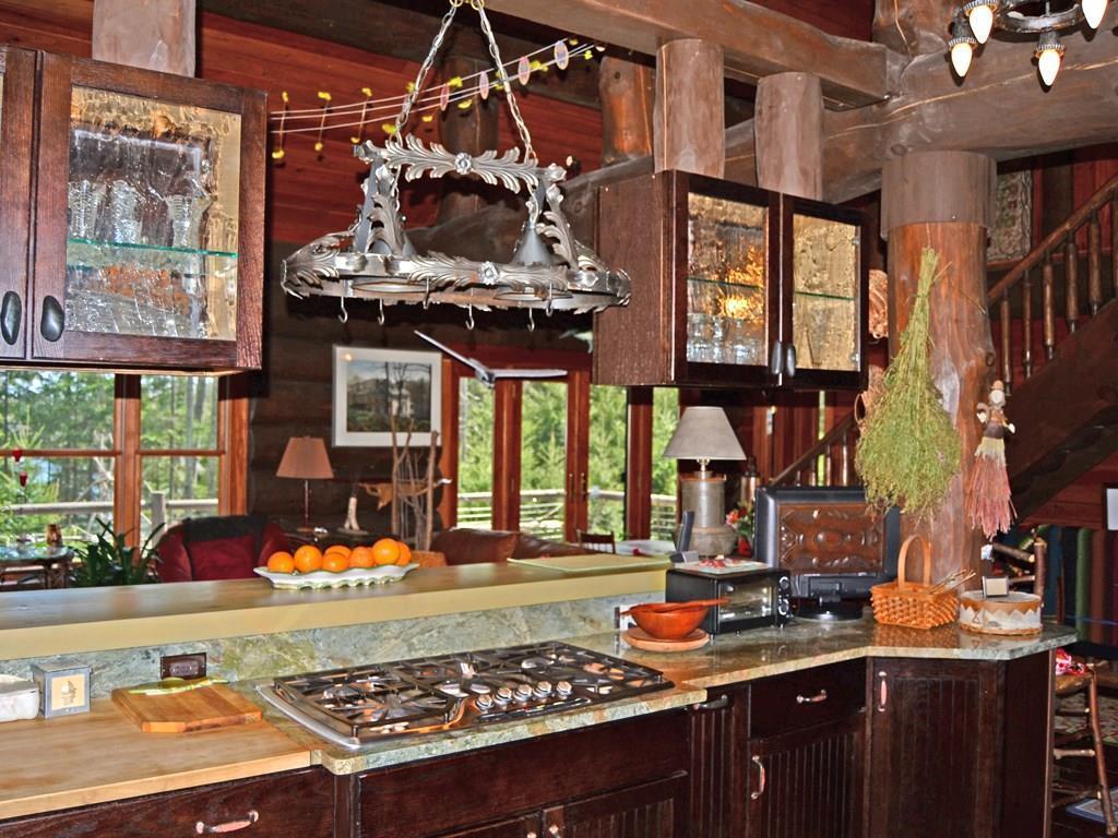 Kitchen boasts granite counter tops...