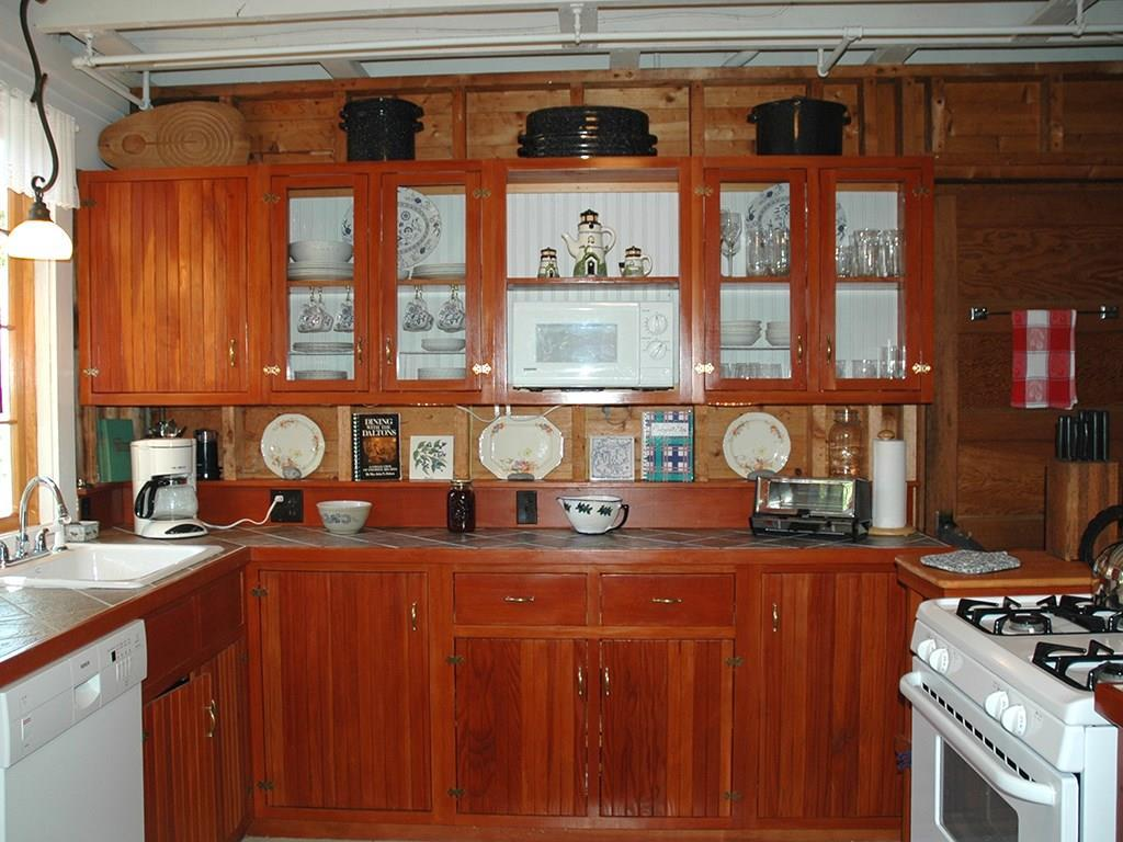 Glass cabinetry is a nice feature in...