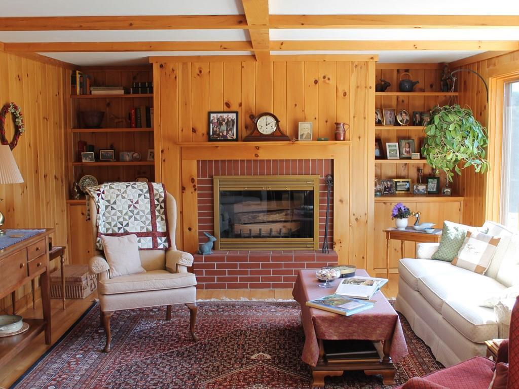 Cozy living room with fireplace, now...