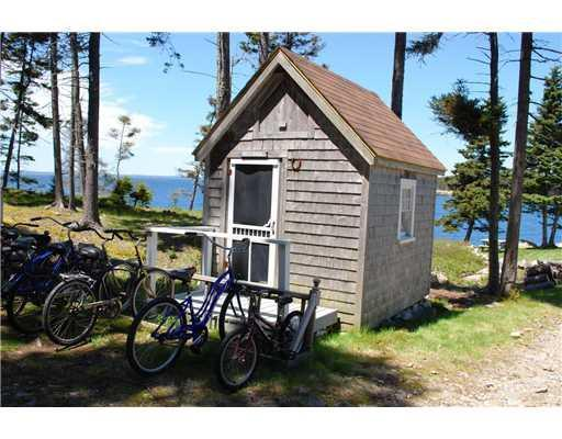 Exterior Front. Bicycles line the...