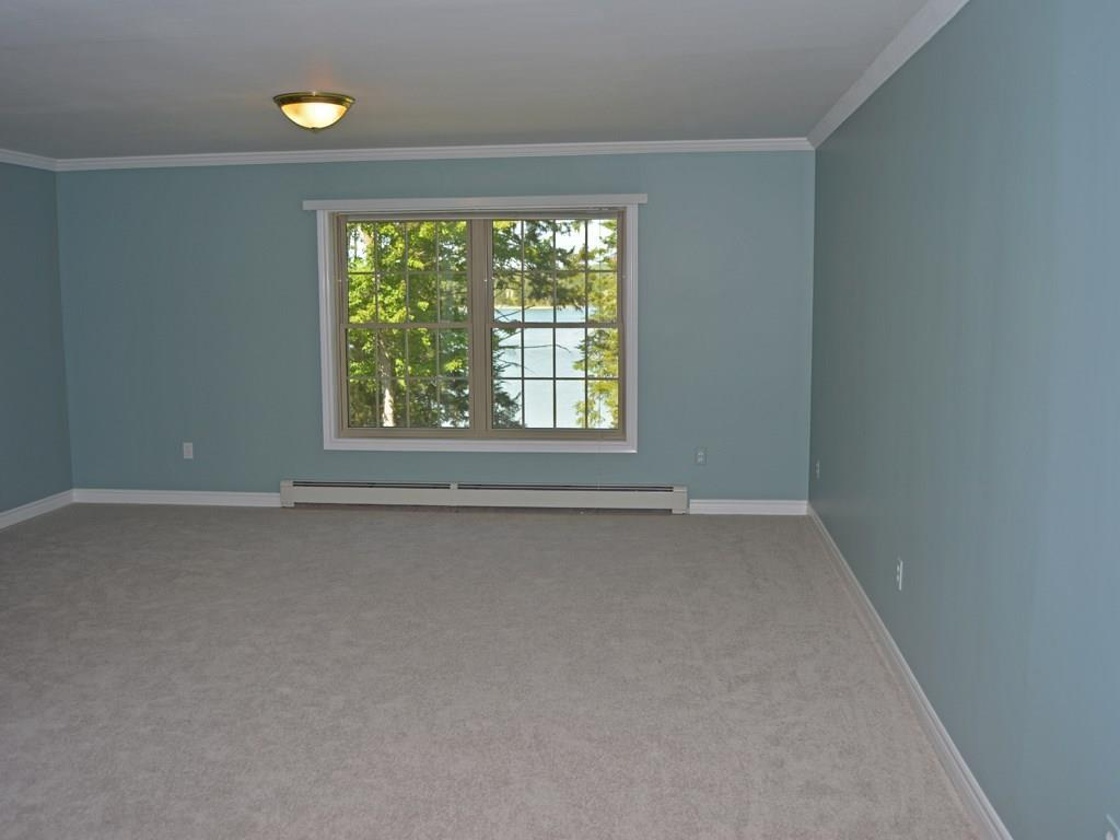 The spacious master bedroom is newly...