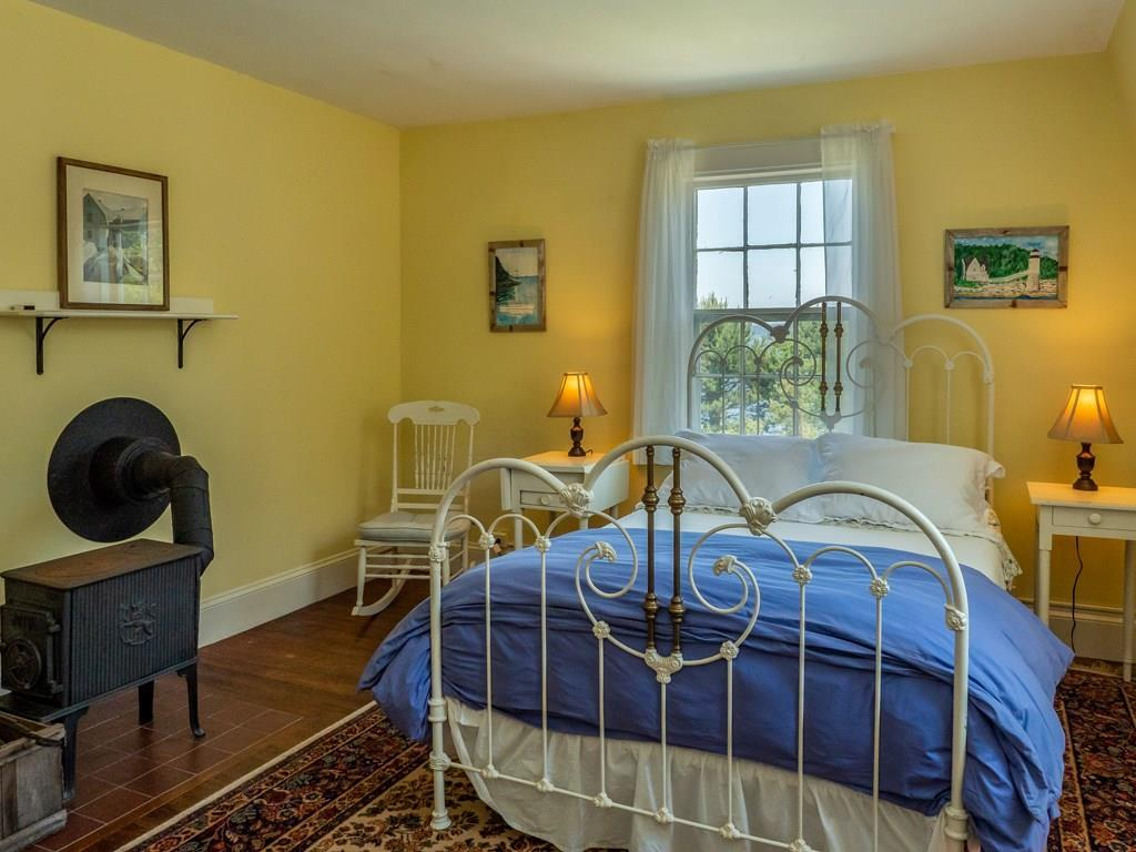 Sunny guest bedroom with wood stove.