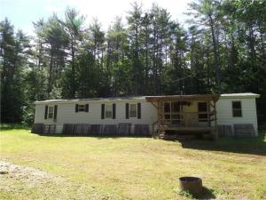 43 ac with 1024 ft on RT 117 East Main ST. Denmark. near skiing at Shawnee and Moose Pond town beach. value is in the land, this mobile was used as a hunting camp and summer visits. includes a shed and a Kabota