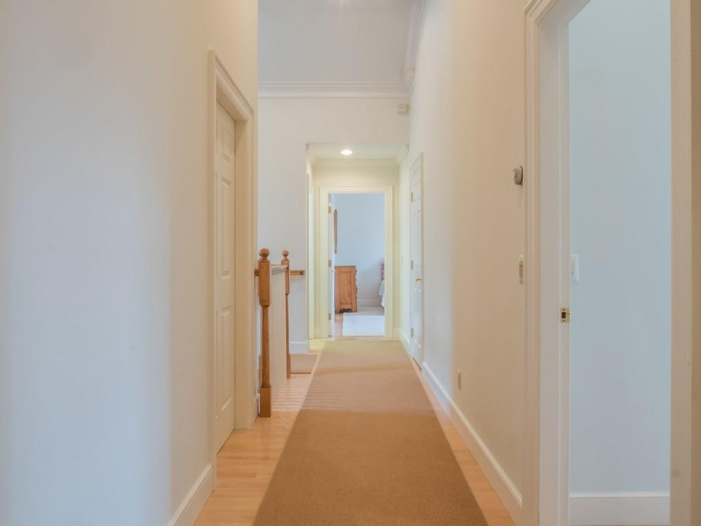 Hallway contains a large linen...