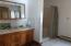 Master bath with shower, and separate jetted tub.