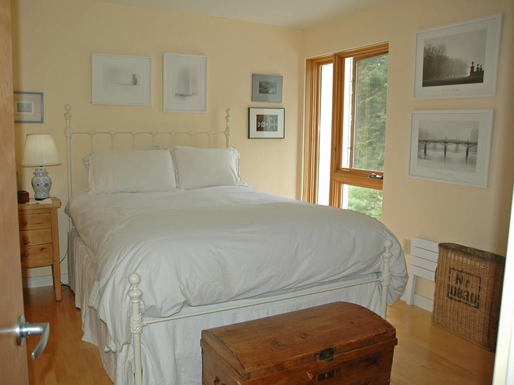 Bedroom with a view to the wooded...