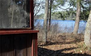 60 Fox Cove Road, Kezar Lake. Existing cottage structure is so close to the shore.