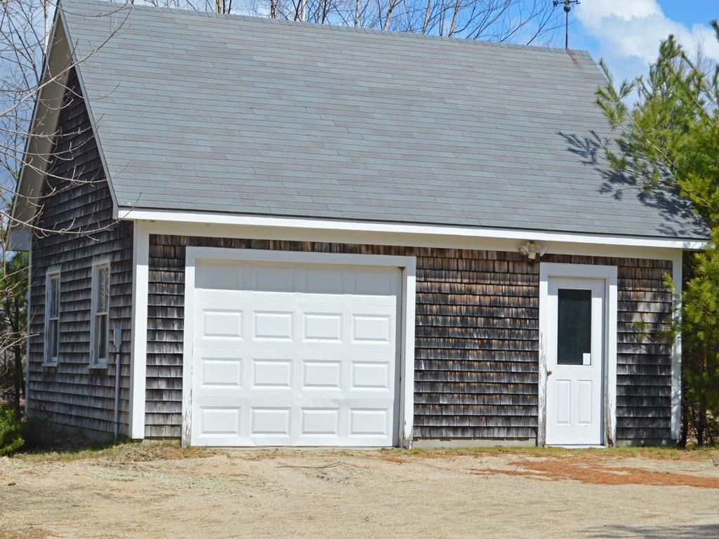 Detached garage with storage.